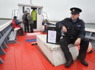 Garda Brendan McCann takes a ballot box to Inishfree Island in September 2009 during the Lisbon Treaty referendum.