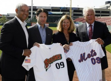 Billionaire Robert Rich (right) and his wife Mindy pose following the announcement of a development contract between the New York Mets and Rich's Buffalo Bisons