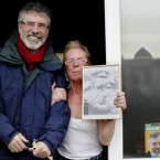 Doesn't Sinn Fein President Gerry Adams look not at all uncomfortable with a supporter on the hustings in Drogheda. Pic: AP Photos/ Peter Morrison.