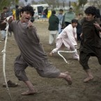 Afghan men fight each other with slings in a traditional game in a park in the centre of Kandahar.<span class=