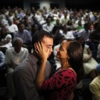 A woman wipes tears from her husband during a mass wedding in Nicaragua on Valentine's Day where 560 couples got married. (AP Photo/Esteban Felix)