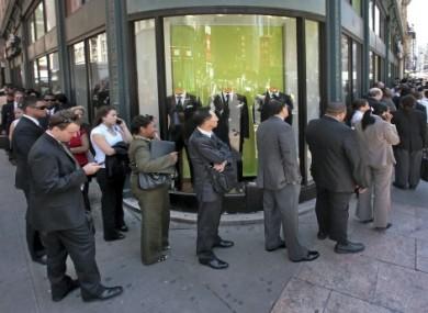 Job seekers wait in line at a New York careers fair
