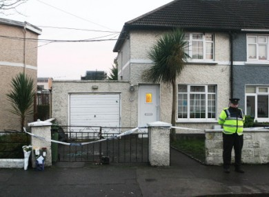 A garda stands at the scene of Aidan O'Kane's shooting in December 2008.