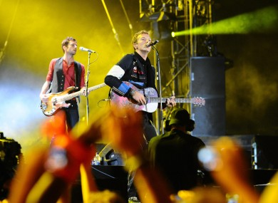 Coldplay's Guy Berryman and Chris Martin: the band will headline the Oxegen festival in 2011, alongside acts like the Black Eyed Peas and Foo Fighters.