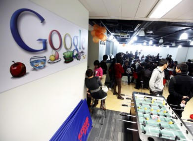 Advertising staff hold a protest at Google's Shanghai offices. Google has accused the Chinese government of being behind problems with the Gmail accounts of Chinese users.