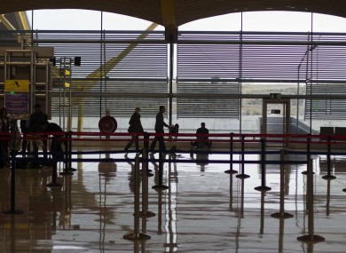 Passengers walk with luggage trolleys at Barajas Airport in Madrid during an air traffic controllers' strike in December.