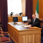 Enda Kenny enjoys his first day behind the Taoiseach's desk in government buildings, keeping on top of the news with his internet connection and - could it be? - yes, his Aertel monitor. (Pic: Stephen Kilkenny)
