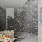 The ceiling begins to fall in at the same bookstore in Sendai, northern Japan. (AP Photo/Kyodo News)