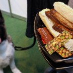An owner holds a hot dog away from its canine pal at Britain's annual Crufts dog show at the NEC Arena in Birmingham. (AP Photo/Simon Dawson)