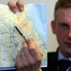 Det Supt Raymond Murray with a map of the area where the PSNI will concentrate fresh investigations in Antrim. Image: PA Images/Paul Faith.
