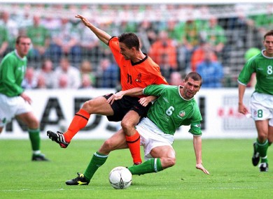 Roy Keane welcomes Dutch winger Marc Overmars to Dublin in September 2001.