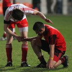 Fair play: Tyrone's Matthew Donnelly consoles a Down player after their Cadbury's Ulster U-21 Football Championship clash.<span class=