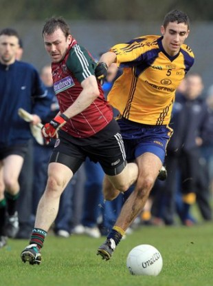 James McCarthy of DCU battles with Ryan Boyle of St Mary's in the Sigerson Cup