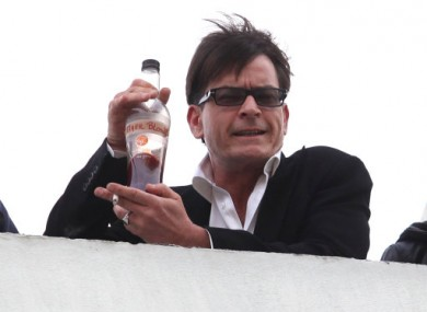 Charlie Sheen holds a bottle of 'Tigerblood' on a Beverly Hills rooftop.