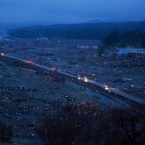 Vehicles pass through an apocalyptic scene - this is what is left of the city of Minamisanriku in northeastern Japan. (AP Photo/David Guttenfelder)