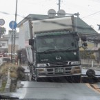A truck is stranded on a road damaged by the quake in Iwaki city, Fukushima prefecture. (AP Photo/Kyodo News)