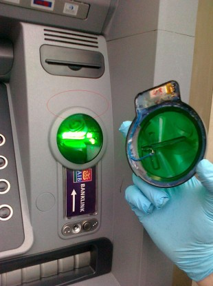 A new ATM Skimming scam where the front of the ATM is replaced with a very sophisticated skimming device.
