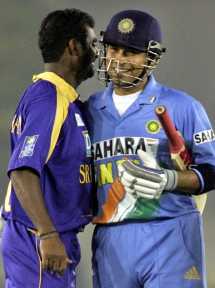 Sri Lanka's Muttiah Muralitharan, left, congratulates India's Sachin Tendulkar in 2005.