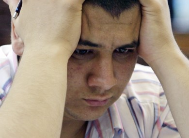 A Turkish student holds his head during the nation's university entrance exam.