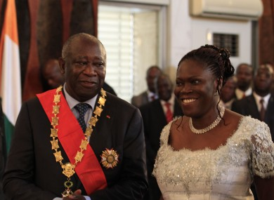 Laurent Gbagbo stands with his wife Simone during his swearing-in ceremony at the Presidential Palace in Abidjan in December. Both he and Alassane Ouattara, considered the winner of the election, took oaths of office as Gbagbo refused to cede power.