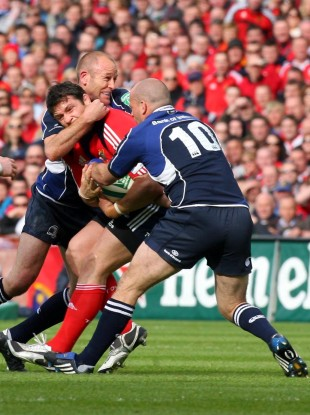 Leinster's Chris Whitaker and Felipe Contepomi tackle David Wallace of Munster.