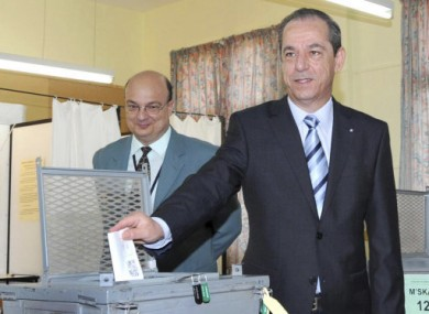 File photo of Malta's Prime Minister Lawrence Gonzi casting a vote in the 2009 European elections.
