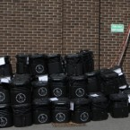A member of the count staff takes a break next to empty ballot boxes outside Ards Leisure centre where the count for Northern Ireland first Minister Peter Robinson's East Belfast Assembly seat is taking place. (Pic: Niall Carson/PA Images)