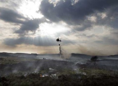 A helicopter drops water on a gorse fire outside Pontoon, Co Mayo at the weekend