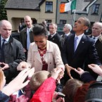 The Obamas stayed out hugging and shaking hands on the streets of Moneygall, even as squally showers alternated with bursts of sunshine. (Pic: Maxwells)