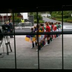 Local schoolkids in county colours wait outside the stadium for the special guest's arrival. (Pic: @JustinMcTDFM)