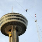 In August 2007, 63-year-old Jay Cochrane repeated his 2005 feat by walking 549 meters (1,800 feet) along a tightrope by the Skylon Towers at the Niagara Falls. (AP Photo/David Duprey)