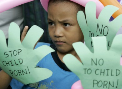 File photo of Filipino children show slogans during a rally as part of Universal Children's Day in Manila in 2008.