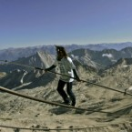 30 August 2009: Swiss tightrope walker Freddy Nock on the 995-meter-long (3,264 feet) cable of the cable railway on top of Germany's highest peak, the Zugspitz. (AP Photo/Diether Endlicher)