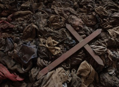A wooden cross lies among clothes from some of the estimated 10,000 Tutsis killed in a two-day massacre at Nyamata church, now a memorial to the 1994 genocide, in the town of Nyamata, Rwanda