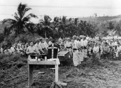 Captain FX Shannon officiating at a memorial service for fallen US troops in the Philippines on 3 February, 1945.