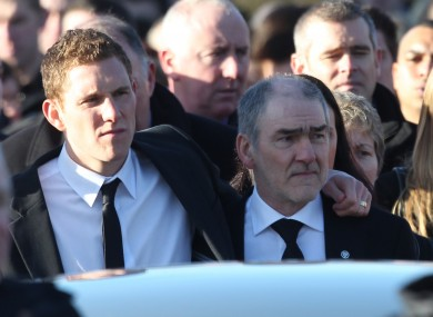Husband John and father Mickey Harte walk behind the hearse carrying the remains of Michaela McAreavey to St Malachys Church near Ballygawley in Co Tyrone.