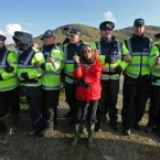 Shell to Sea activist Maura Harrington leans on gardai at the Shell plant at Glengad beach in Co Mayo in 2009.
