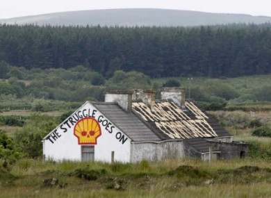A Shell to Sea slogan painted on an abandoned house just outside of Rossport village in Co. Mayo