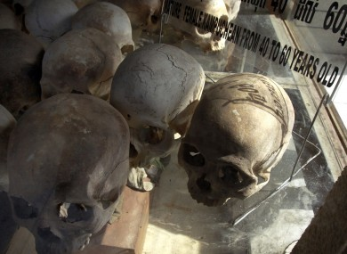 Human skulls of the Khmer Rouge's victims are on display at Choeung Ek stupa, former Khmer Rouge killing field in the outskirt of Phnom Penh