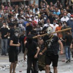 Protesters challenge police during a demonstration in Athens. Pic: AP Photo/Petros Karadjias
