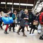 Music fans leave Paddington Station in London, as they travel down to the Glastonbury Festival in Somerset. Pic: Ian West/PA Wire