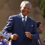 Mandela dances after becoming the first black president of South Africa. (John Parkin/AP)