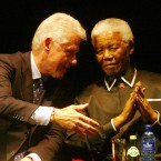 Mandela remained active in world affairs after his retirement. Here he speaks with Bill Clinton in 2005. (AP Photo/Themba Hadebe)