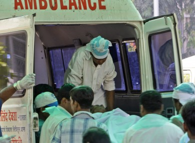 Medics assist the victims of a siege in Mumbai in 2008. The city has been hit by bomb blasts this evening, in what is thought to be a terrorist attack.