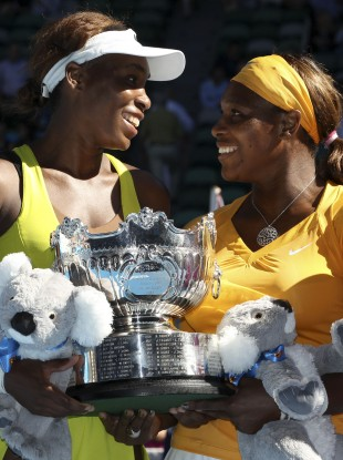 Venus and Serena Williams celebrate victory in the Women's Doubles at the 2010 Australian Open.