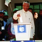 Casting his vote in the country's first all-race elections in 1994. The ANC would sweep to victory. (AP Photo/John Parkin)
