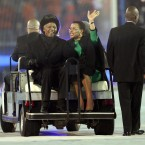 Nelson Mandela and his third wife Gracie wave to the crowd during the closing ceremony of the 2010 South Africa World Cup. (Mike Egerton/Empics)