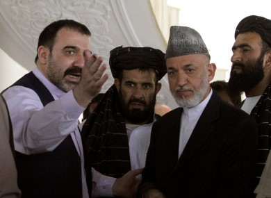 Ahmed Wali Karzai with his brother Hamid Karzai in Kandahar province in October last year.