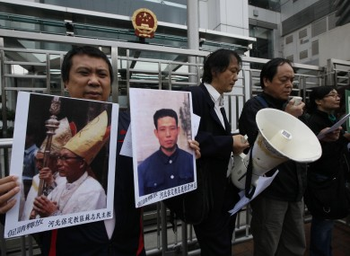 Catholics from Hong Kong protest against China's plans to appoint a bishop without Vatican approval in December. Yesterday's excommunication is the third in eight months.