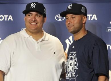 New York Yankees' Derek Jeter, right, with Christian Lopez.